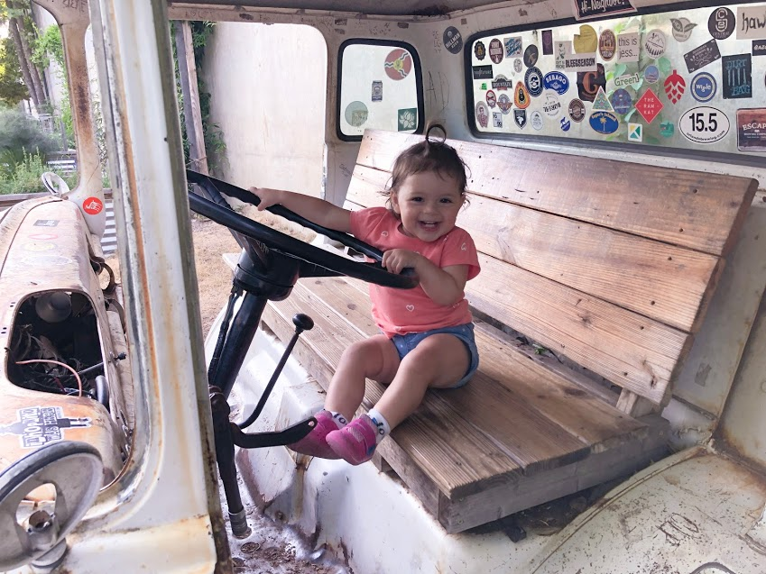 My daughter loved the truck cab that is converted into seating outside at Burial Brewing Co. in Asheville, NC