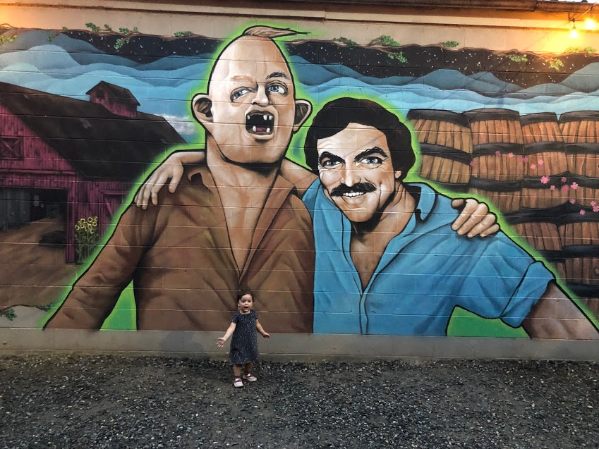 My daughter Ariana posing with Tom Selleck and Sloth at Burial Brewing Co. in Asheville, NC